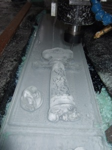 Photo showing a relief representation of the hunting knife being carved